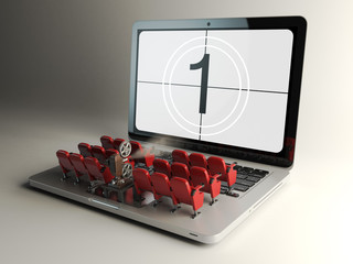 Video player application  or home cinema concept. Laptop and row