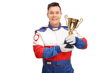 Car racing champion holding a trophy