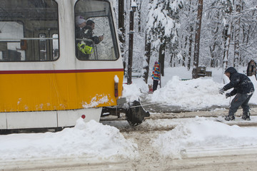 Sofia, Bulgaria - January 17, 2016: Extreme Snowboard ride behind a tram in Sofia, Photo taken on: January 17th, 2016