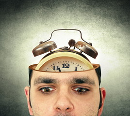 man with the open head and alarm clock
