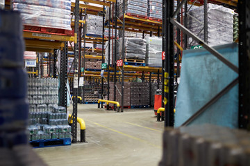 Aisles between storage racks in a distribution warehouse