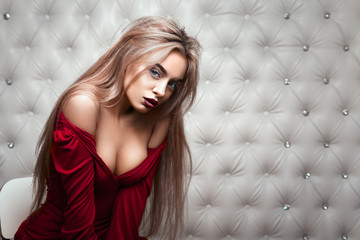 Studio portrait of a sexy blond in red dress