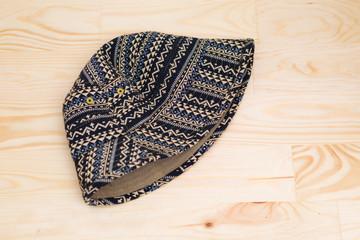 Textile cap onwooden background