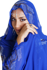 Young traditional Asian Indian woman in indian blue sari