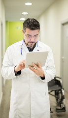 Doctor uses a tablet in hospital