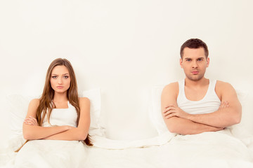 Upset angry man and woman having marital problems
