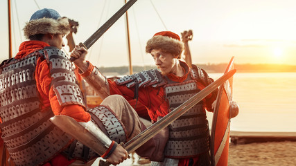 Battle of two medieval knights with swords and shields. Warship