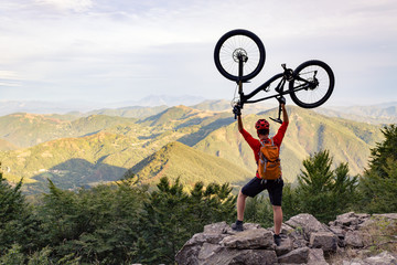 Mountain biker success, looking at mountains view