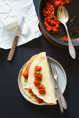 Omelet with roasted cherry tomatoes and  white cheese