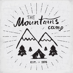 Mountains handdrawn sketch emblem. outdoor camping and hiking activity, Extreme sports, outdoor adventure symbol, vector illustration on grunge background