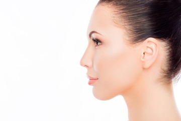 Side view portrait of attractive woman's face on white backgroun