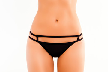 Close up photo of  black women's panties and slim belly