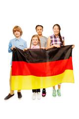 Four multiethnic teenage kids holding German flag
