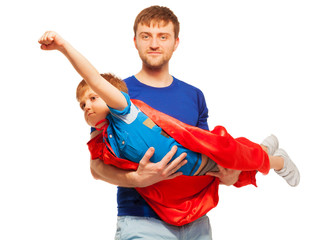Super hero kid having fun with his dad