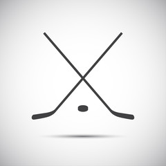 Simple crossed hockey stick with puck, vector icon