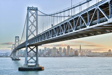 Sunset over San Francisco-Oakland Bay Bridge and San Francisco Skyline. Yerba Buena Island, San Francisco, California, USA.