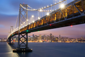 Dusk over San Francisco-Oakland Bay Bridge and San Francisco Skyline, California, USA.