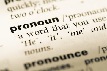 Close up of old English dictionary page with word pronoun Wall mural