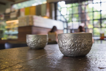 Craving silver cup in thai traditional old style with ice cold water fresh ready to drink on table in dinning room or restaurant/craving silver cup with ice cold water