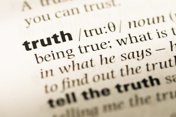 Close up of old English dictionary page with word truth