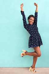 Happy Excited African American Woman In Summer Dress