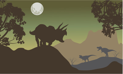 Silhouette of triceratops and baby T-Rex