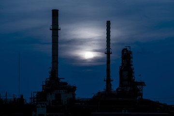 Silhouette of oil refinery factory in night