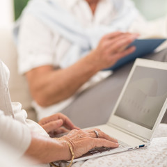 Senior female using laptop