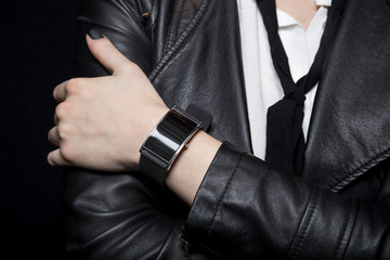 Black smart watch on a female model wearing stylish punk style leather