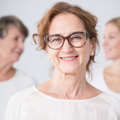 Smiling mature woman in glasses