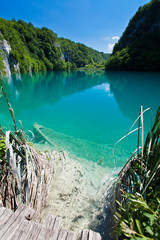 Wall Mural - Submerged boat in Plitvice national park
