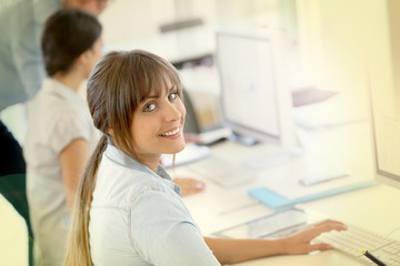 Portrait of young businesswoman working in office