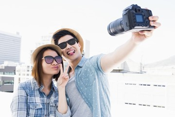 Happy young couple clicking a picture