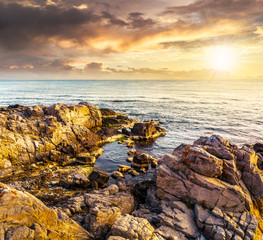 sea landscape on the rocky coast at sunset