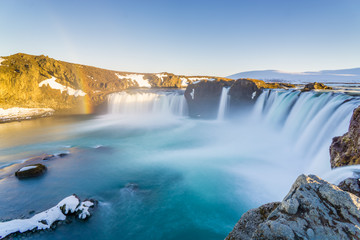 Huge waterfall with rainbows in Iceland Wall mural