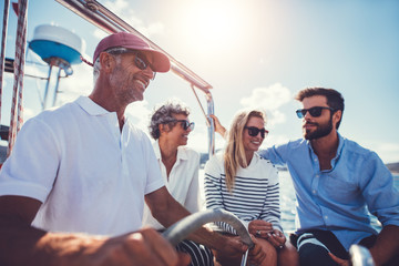 Happy people on yacht