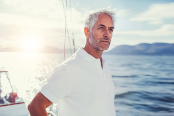 Portrait of mature man standing on boat