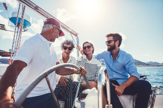 Happy family on yacht