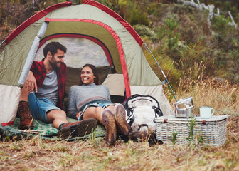 Loving young couple sitting in at tent