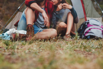 Couple camping outdoors