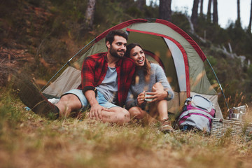 Happy young couple enjoying on camping