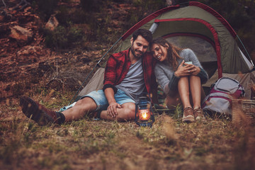 Young camping couple caught in a lovely moment
