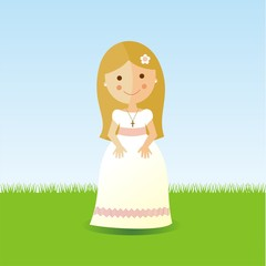 First Communion girl with blond hair in a garden