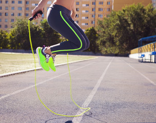 Obraz Woman with jumping rope. Beautiful young woman with a jumping ro - fototapety do salonu