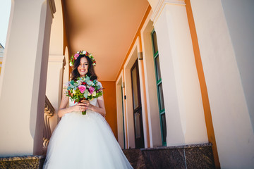 sweet love bride standing on stairs and smiling to the photograp