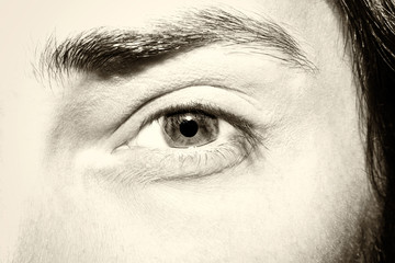 Image of man's vintage eye close up.
