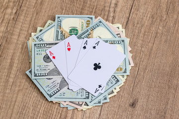 poker cards with dollar on wooden table