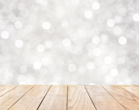 Wooden table on white abstract background