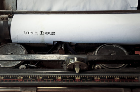 close up image of typewriter with paper sheet and the phrase: lorem ipsum. copy space for your text. retro filtered