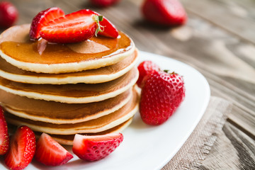 pancakes with fresh srtawberry on a table